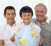 Family looking at a terrestrial globe Stock Photography