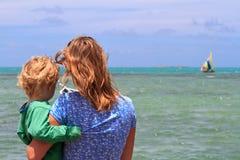 Family looking at tropical beach Stock Photos