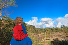 Family looking at waterfall in Mauritius Stock Photography