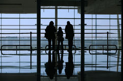 Family looking through the window. In the airport Royalty Free Stock Photo