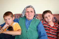 Family love. Grandmother and two grandsons family Stock Image