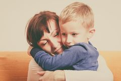 Mother hugging her son, little boy. Family love, beauty of parenting concept. Mother hugging her son, little young boy royalty free stock images