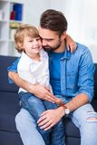 Family and love concept - young father embracing his little son. At home Royalty Free Stock Photos
