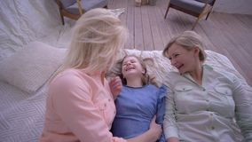Family love, happy mother with daughters together have fun time and fall on bed stock video