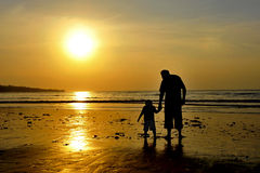 Family Love at The Sunset. On the beach the grandfather and his grandson were waiting for the sun slowly falling close to sea level Royalty Free Stock Images