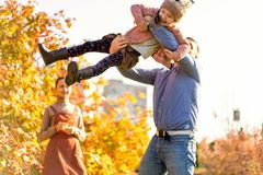 Family in love walks in autumn park royalty free stock photography