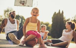 We are a family that loves sports and fun outside. Family on basketball playground. Close up royalty free stock photo