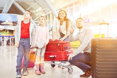 Family with luggage at the airport or train station stock photo