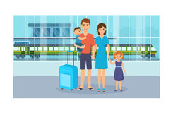 Family with luggage is in building of the railway station. People at railway station are waiting for the arrival of train. Family with children with luggage on Stock Photos