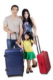 Family with luggage in studio. Happy asian family carrying luggage and ready to holiday, isolated over white background Stock Photos