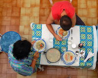 Family lunch. Mother serving a lunch to her teenage son Stock Photography