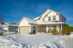 Family luxury house with front yard in snow Stock Image