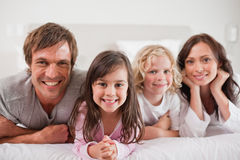 Family lying in a bed Stock Photo