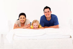 Family lying on bed Royalty Free Stock Image