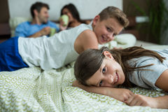 Family lying on bed in bedroom. At home Stock Photo