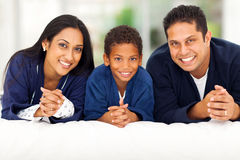Family lying bed Stock Images