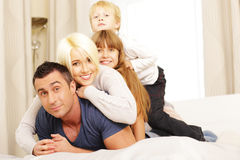 Family lying on the bed Royalty Free Stock Photography