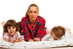 Family lying in bed Stock Photo