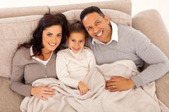 Family lying couch Stock Images