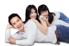 Family lying and cuddling in studio Stock Photo