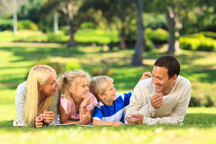 Family lying down in the park Royalty Free Stock Photography