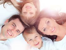 Family lying down Stock Images
