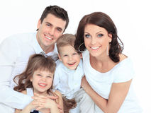 Family lying down on their bed at home Royalty Free Stock Images