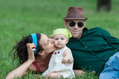 Family lying in a field Royalty Free Stock Photo