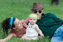Family lying in a field Royalty Free Stock Photography