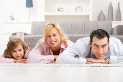Family lying on floor royalty free stock image