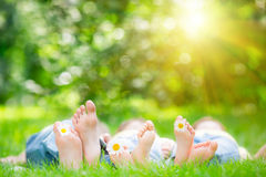 Family lying on grass. Outdoors in spring park royalty free stock images