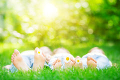 Family lying on grass. Outdoors in spring park Royalty Free Stock Photos