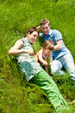 Family lying in grass Stock Images