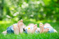 Family lying on grass. Outdoors in spring park Stock Photography
