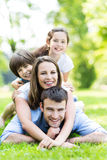 Family lying on grass. Portrait of a happy family outdoors Royalty Free Stock Images