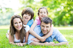 Family lying on grass. Portrait of a happy family outdoors royalty free stock photography