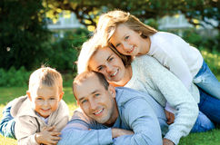 Family lying on the grass. And smiling Stock Photo