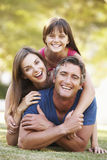 Family Lying On Grass In Summer Park Royalty Free Stock Photography