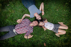 Family lying on the grass top view Stock Photos