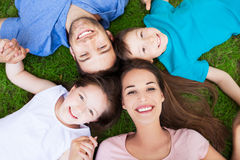 Family lying on grass Royalty Free Stock Photos