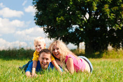 Family lying on meadow Stock Photo