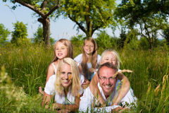 Family lying in the meadow Royalty Free Stock Image