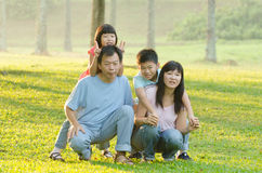 Family lying outdoors being playful and smiling Royalty Free Stock Images
