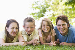 Family lying outdoors smiling Stock Photos