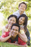 Family lying outdoors smiling Stock Photography
