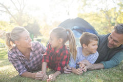 Family lying outside the tent on a sunny day Royalty Free Stock Photography
