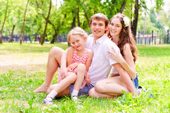 Family lying in the park Royalty Free Stock Photo