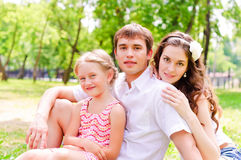 Family lying in the park Royalty Free Stock Images