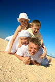 Family lying on sand Royalty Free Stock Photography