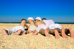 Family lying on sand Royalty Free Stock Image